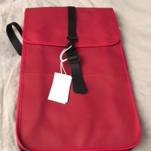 NWT Backpack water-resistant Rains
